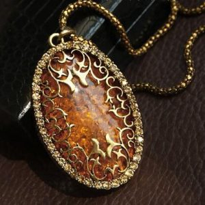 Vintage European Style Women Royal Hollow Pattern Amber Long Pendant Necklace